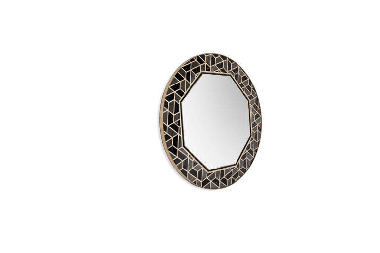 This unique mirror is inspired in the tortoises hard outer shell. It's made of high gloss black lacquered wood that contrasts with hexagonal Anthracite, Nero Marquina and Yellow Triano marble details. This glamorous pattern makes this piece easy to