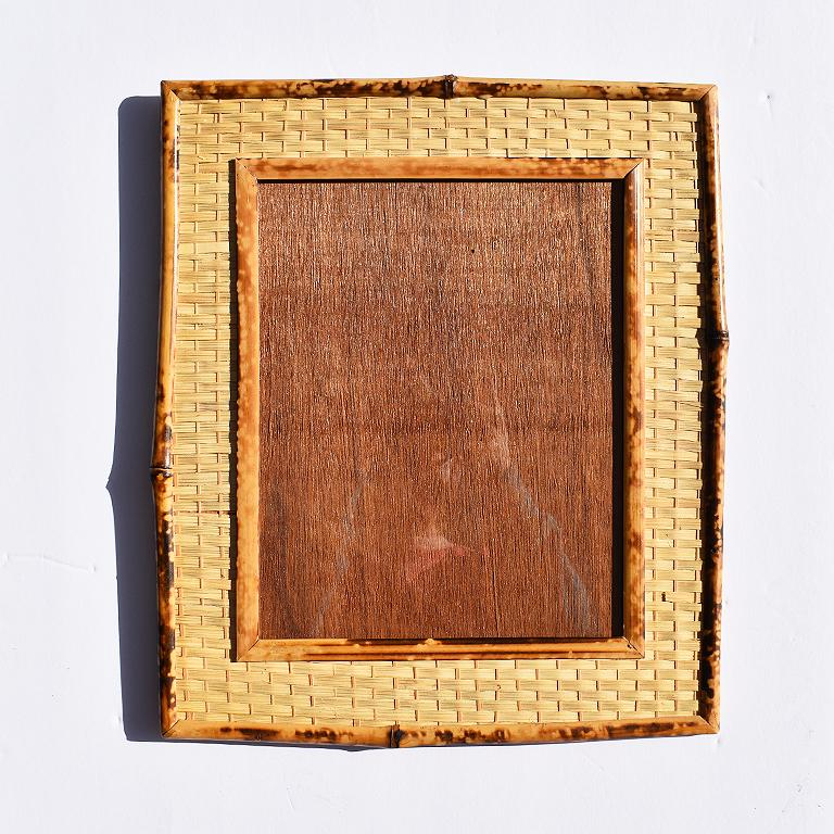 Scorched bamboo (or commonly referred to as tortoiseshell or tiger bamboo) light brown and deep brown photo frame with scorched bamboo and wicker exterior. 