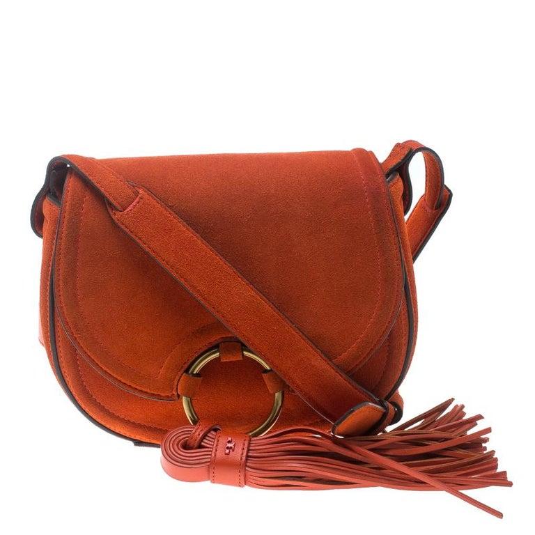 55afe15b2873 Tory Burch Orange Suede Mini Tassle Saddle Bag For Sale at 1stdibs