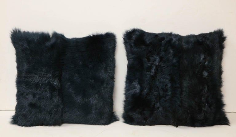 Beautiful Toscana long hair shearing pillow in deep forest color with leather backing in dark plum color. Soft and smooth in touch and has intriguing texture and shine that resembles brush strokes. It is made of genuine shearing with a zipper