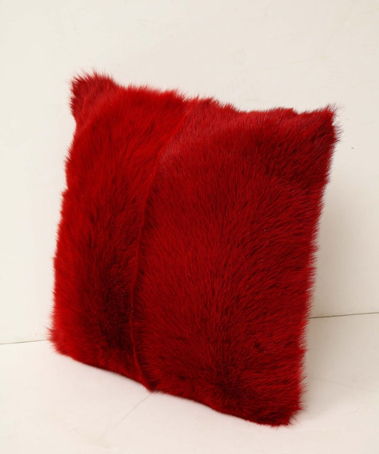 Ravishing Toscana long hair shearing pillow in red color with matching red colored leather backing. Soft and smooth in touch, and fashion red that evokes a stylish statement in any space. It is made of genuine shearing with a zipper enclosure in a