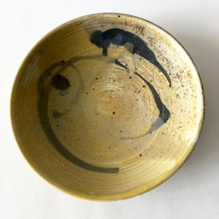 Studio pottery low bowl with abstract design created by Toshiko Takaezu, of Honolulu, Hawaii. Bowl measures 2