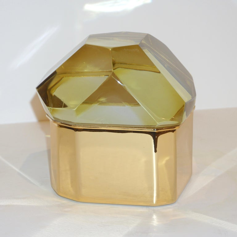 Italian contemporary organic glamorous casket, entirely handcrafted, by Toso Vetri d'Arte (Murano) with a freeform handmade geometric brass case, handcut like a diamond, in a sophisticated gold yellow blown rock Murano glass, transparent depending