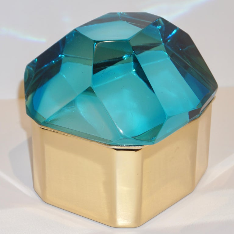 Italian contemporary organic casket, entirely handcrafted, by Toso Vetri d'Arte (Murano) with a freeform geometric brass case embellished by a turquoise blue cover in blown rock Murano glass, hand-cut like a diamond. Available also in Amber Gold and