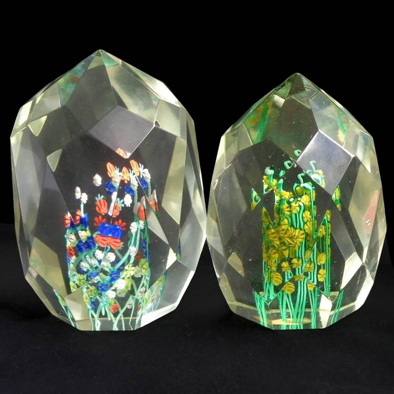 Beautiful pair of Murano handblown, diamond cut faceted wild flower Italian art glass paperweights. Documented to the Fratelli Toso company. Each has its own different cut surface, and different flower colors.