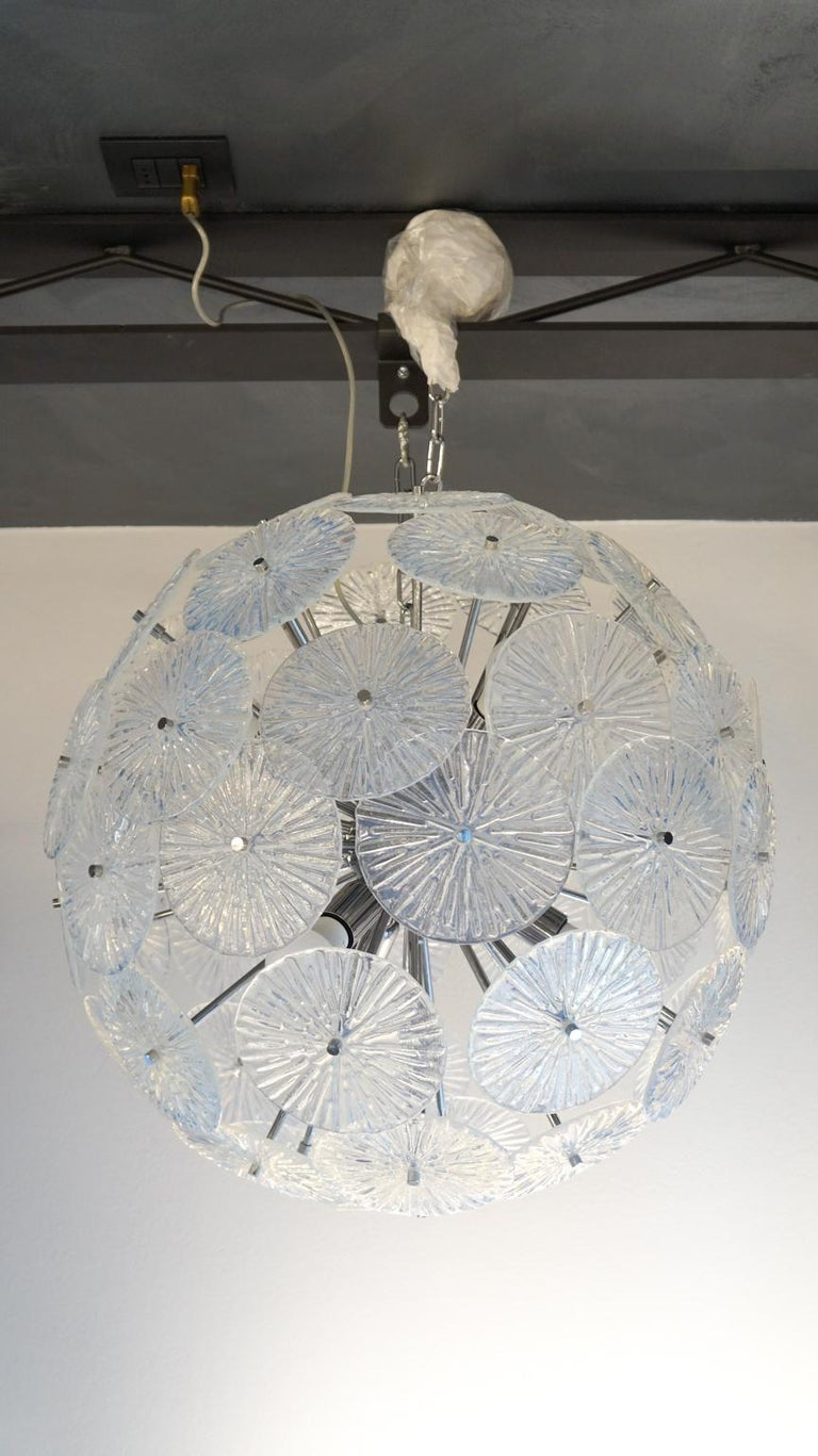 Fantastic Sputnik chandelier in blown Murano glass with 65 elements, crystal color. The chandelier can be reconditioned according to the country of destination. Six E27 / E26 bulbs. This chandelier is a project of the Murano glass master Stefano