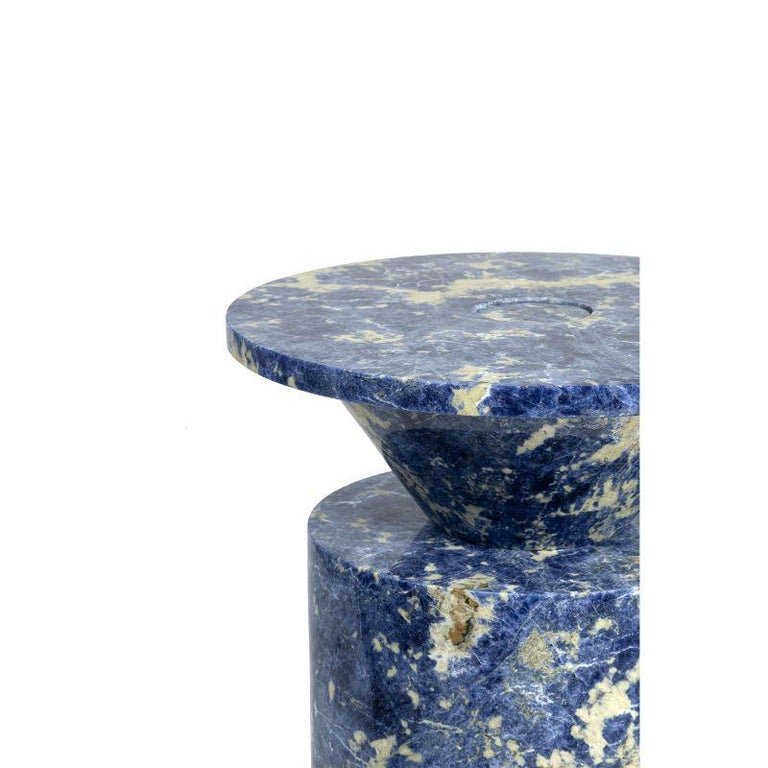 Totem in Blu Sodalite Marble table by Karen Chekerdjian Dimensions: 42 x 42 x 62 cm Materials: Blu Sodalite Marble  Karen's trajectory into designing was unsystematic, comprised of a combination of practical experience in various creative fields