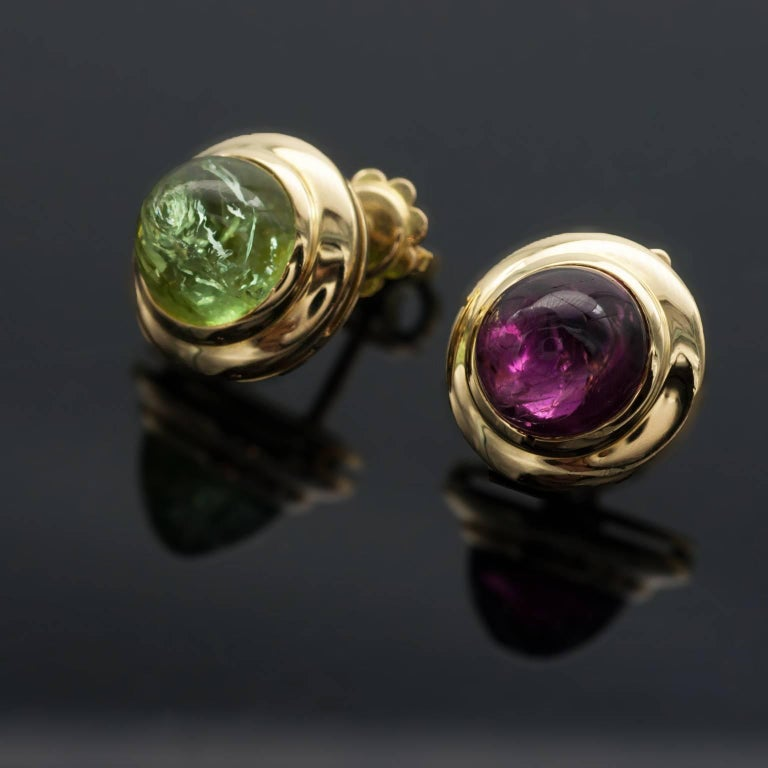 Joyful stud earrings and pendant set: Pink and green tourmaline cabochon simply but perfectly set in 18Kt Yellow gold. Details:  Tourmalines: 33.5 carat ; Diamonds: 0.12 carat G VS Measures:  Earrings: 1.3 cm - Pendant 4.5 x 2.4 cm