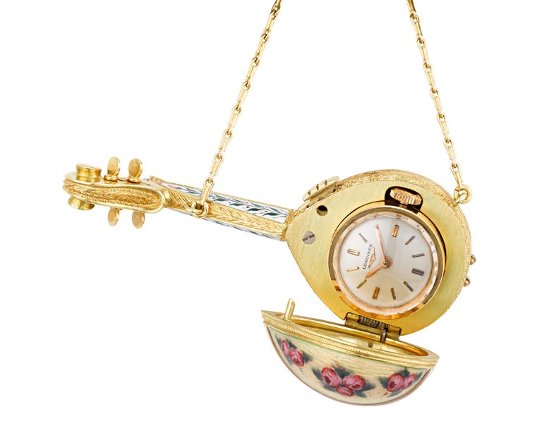 Vibrantly colored enamel adorns the front and back of this petite and charming ladies' lapel watch. The watch is designed as a golden mandolin with a highly detailed enameled and hand-painted floral motif and white diamond accents totaling 0.22