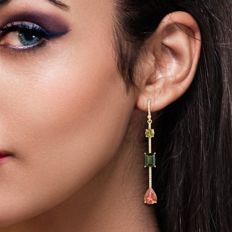 These beautiful linear drop earring are handcrafted in 18-karat gold. It is set with 9.28 carats tourmaline and .29 carats of glimmering diamonds.  FOLLOW  MEGHNA JEWELS storefront to view the latest collection & exclusive pieces.  Meghna Jewels is