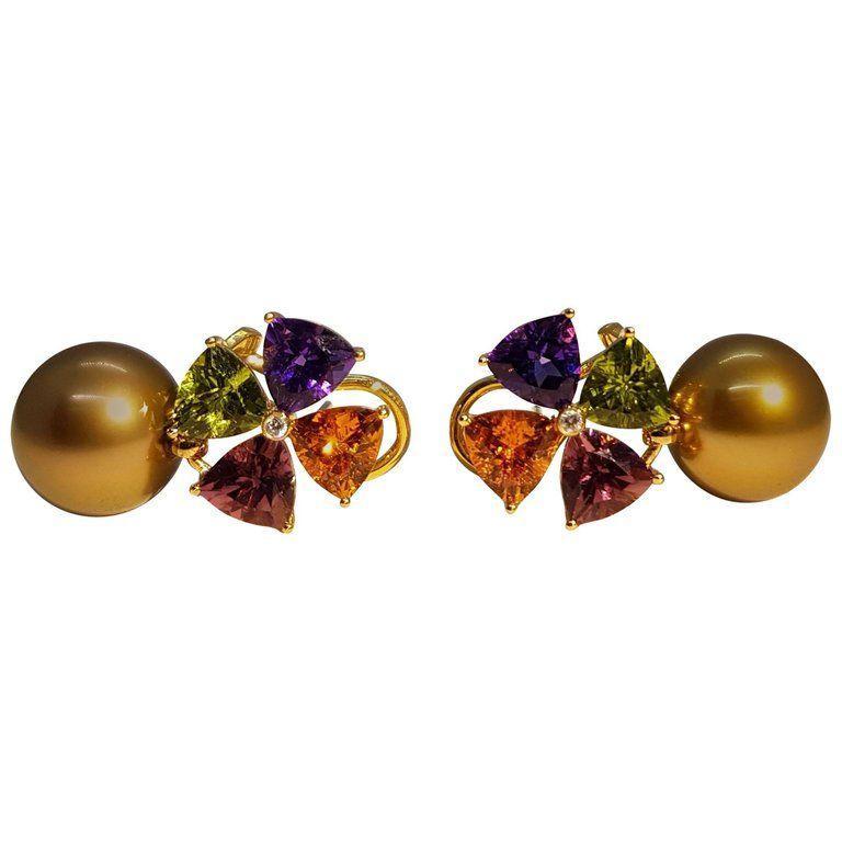 Graceful multi gem earrings made of 750/0 yellow gold, 2 bronze Tahiti pearls 11.3 -11.4 mm, 2 mandarin garnets totaling 1.78 carats, 2 Tourmalines totaling 1.55 carats, 2 Peridots totaling 1.58 carats, 2 Amethysts totaling 1.40 carats and 2