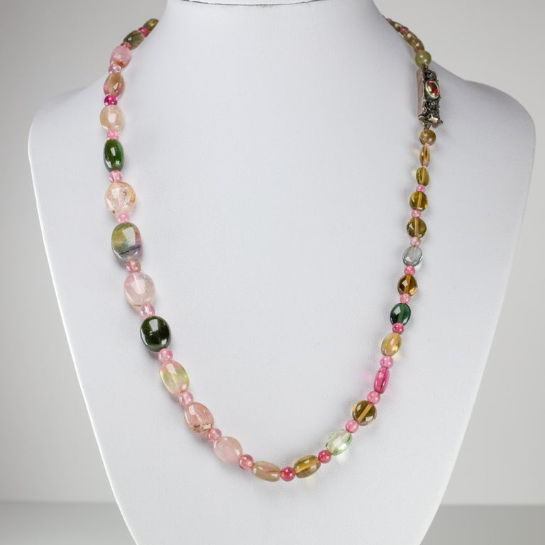 A bright and colorful treasure from the Arts & Crafts period, this English-made necklace is composed of thirty-seven very fine oblong tourmaline beads graduating in size from approximately 8mm to just shy of 14mm. Between these beads are thirty-four