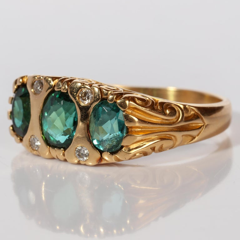 Oval Cut Tourmaline Ring in Gold With Diamonds  For Sale