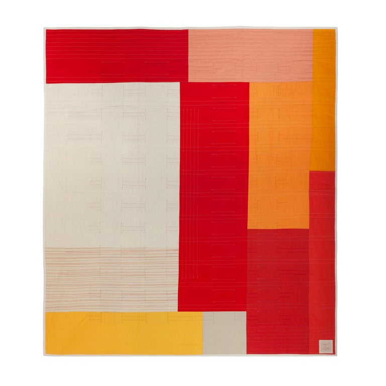 """Tower: 1 (Rage)"" is a cotton quilt created to explore color and push the boundaries of traditional patchwork. These quilts use a weaving technique as well as traditional piecing to push the boundaries of quilt making and question the quilt's form"