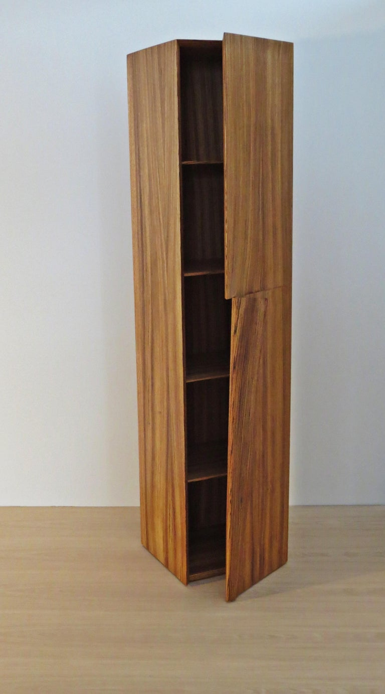 Tall cabinet handmade from solid Zebrano (African Zebrawood).