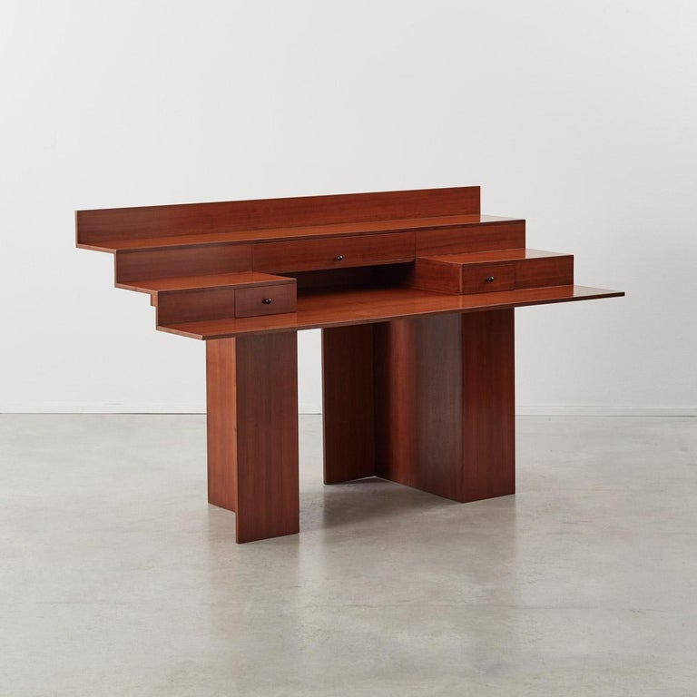 Compasso d'oro winning Architect-designers Marcello Vecchi and Francesco Trabucco, collaborated on this desk in 1983 for Poggi, Pavia, 1983. The Italian maker Poggi (1924-) was famous for championing the designs of other notable architects, the
