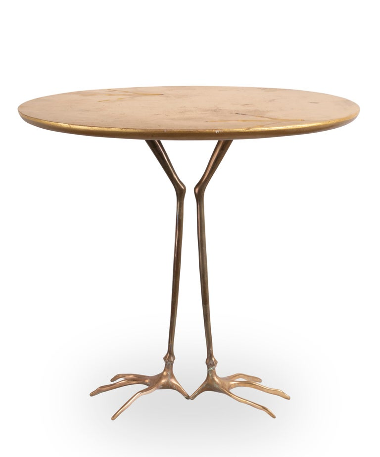 Traccia table designed by Meret Oppenheim Bronze feet, oval gilded wood top showing birds foot prints. Designed by Meret Oppenheim in 1939 Edited by Simon Gavina from 1971  Measures: Height 64 cm (26.2 inches) Length 67.5 cm (26.6 inches)