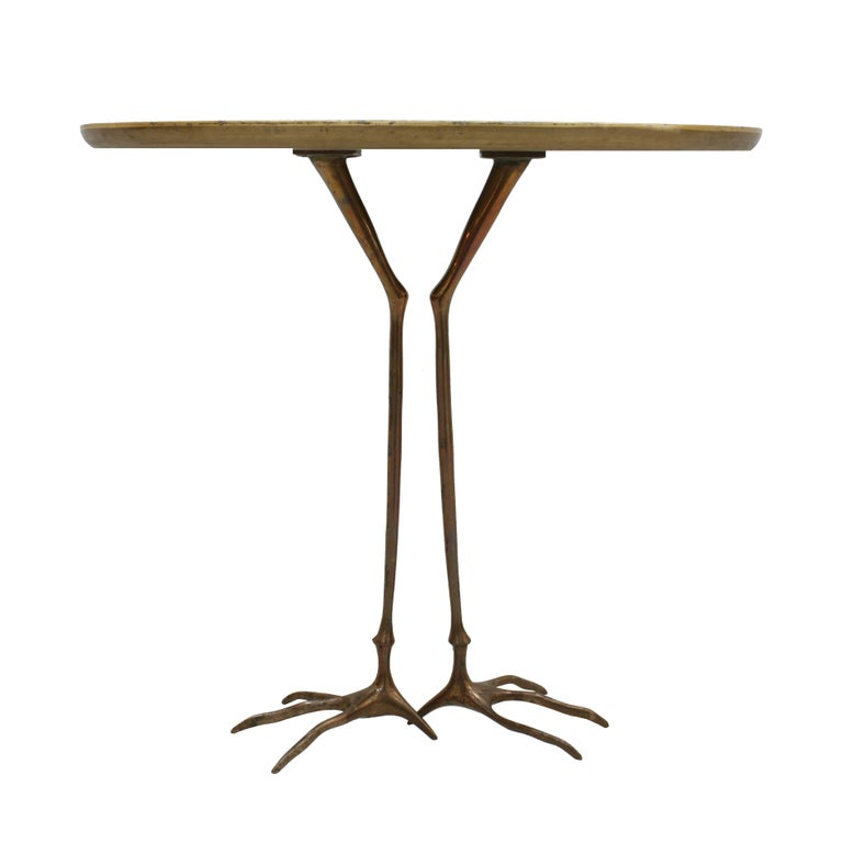 """Traccia"" table, designed by Meret Oppenheim from 1936. Edited by Dino Gavina as part of the ""Ultra mobile"" collection in 1970. Composed of oval over finished in gold leaf and solid bronze sculptural base imitating the legs of a heron. Italy 1970."