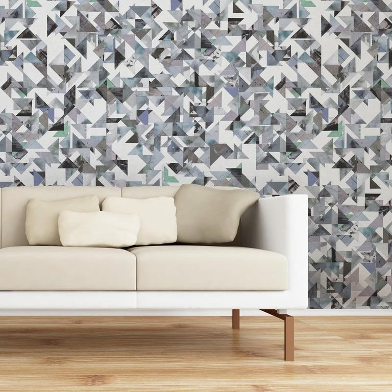 The interplay of precision, randomness, structure and fluidity is expressed in this colorful and mesmerizing wallpaper designed from original artwork by Max Kahan. Max worked with treated paper in a consistent triangle shape to create a free flowing