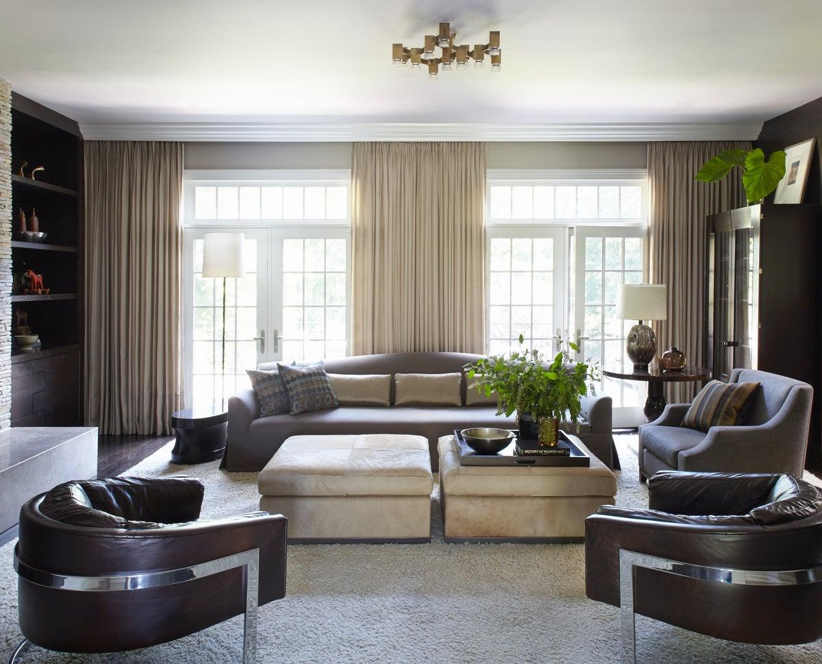 Modern living room in us by neal beckstedt studio for Living room vs den