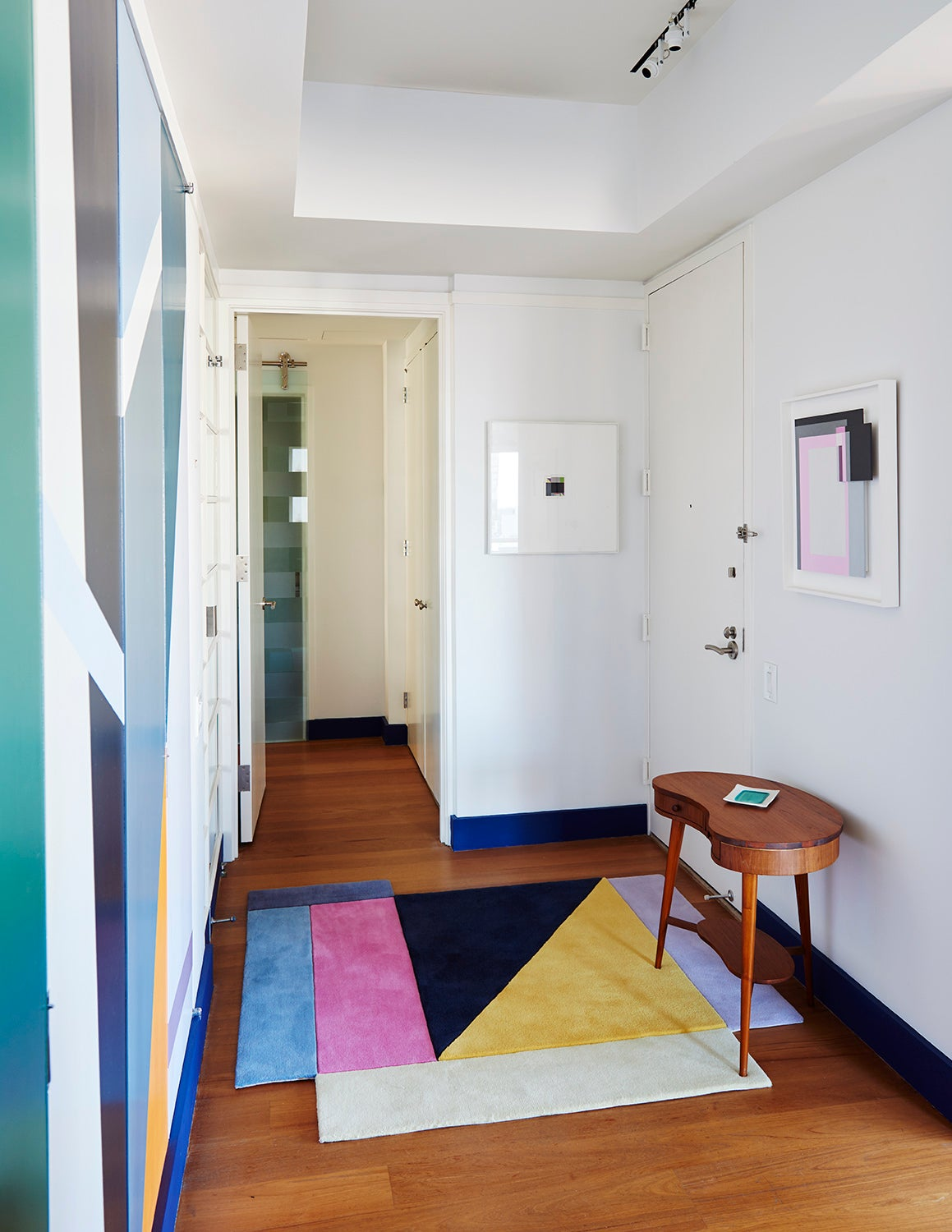 The Apartment Entrance With The Rug Square Within A