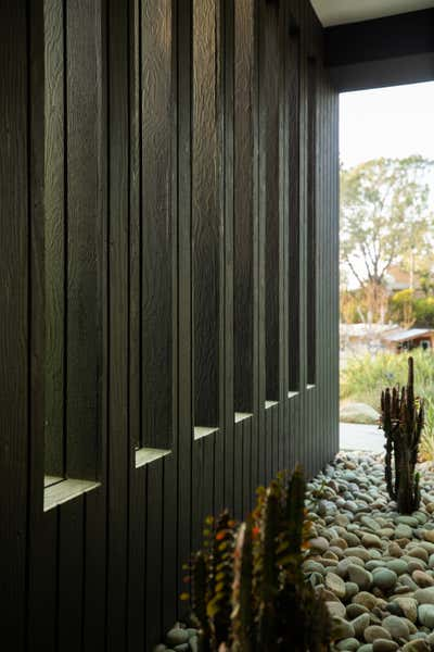 Beach Style Exterior. Pine Needles by Michael Hilal.