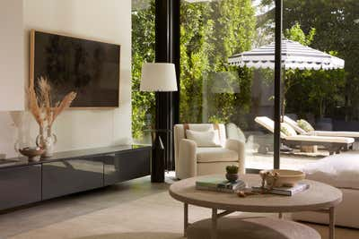 Western Living Room. The Hamptons in Studio City by 22 INTERIORS.
