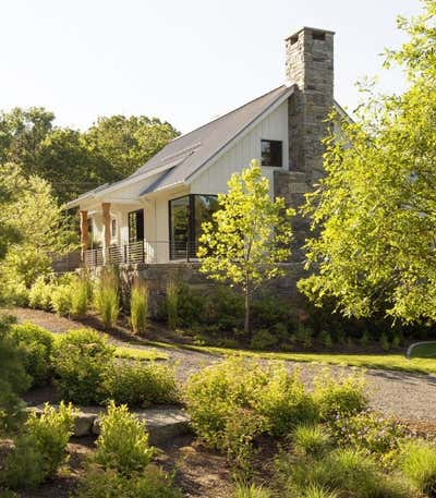 Country Exterior. The Lodge  by The Brooklyn Home Co..