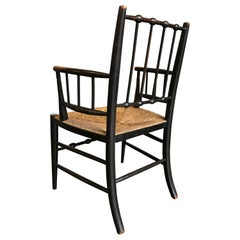 Traditional Antique Sussex Armchair in Ebonised Beech or Ash with Rush Seat
