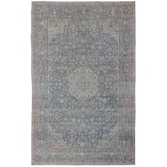 Traditional Design Antique Persian Tabriz Rug with Intricate Floral Medallion