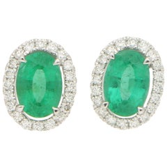 Traditional Emerald and Diamond Cluster Earrings in 18 Karat White Gold