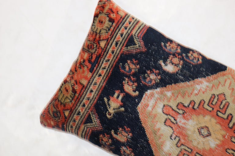 """Pillow made from an antique Persian Hamedan Tribal rug with a cotton back and zipper closure included.  Measures: 15"""" x 31""""."""