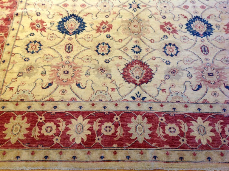 Hand-Knotted Traditional Pakistani Beige Floral Rug with Red and Teal For Sale