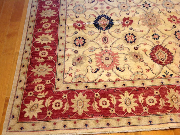 Contemporary Traditional Pakistani Beige Floral Rug with Red and Teal For Sale