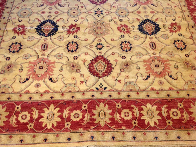 Wool Traditional Pakistani Beige Floral Rug with Red and Teal For Sale