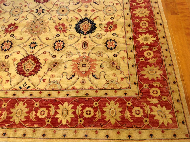 Traditional Pakistani Beige Floral Rug with Red and Teal For Sale 1