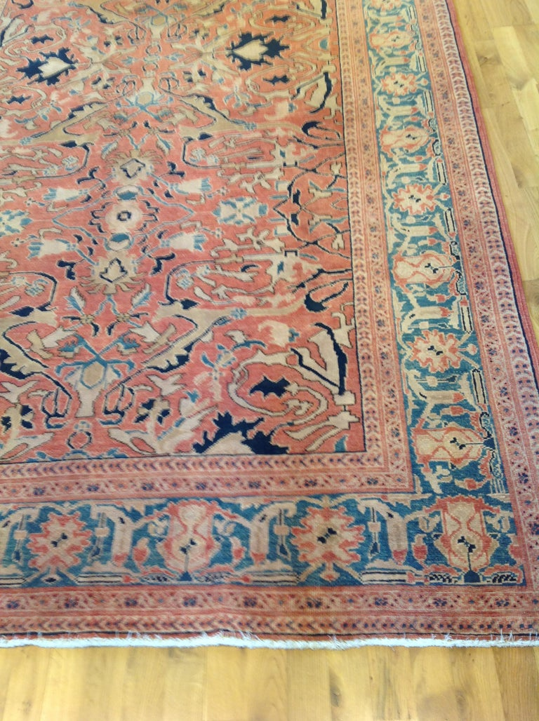 Traditional Pakistani Red Wool Area Rug With Teal Border For Sale At