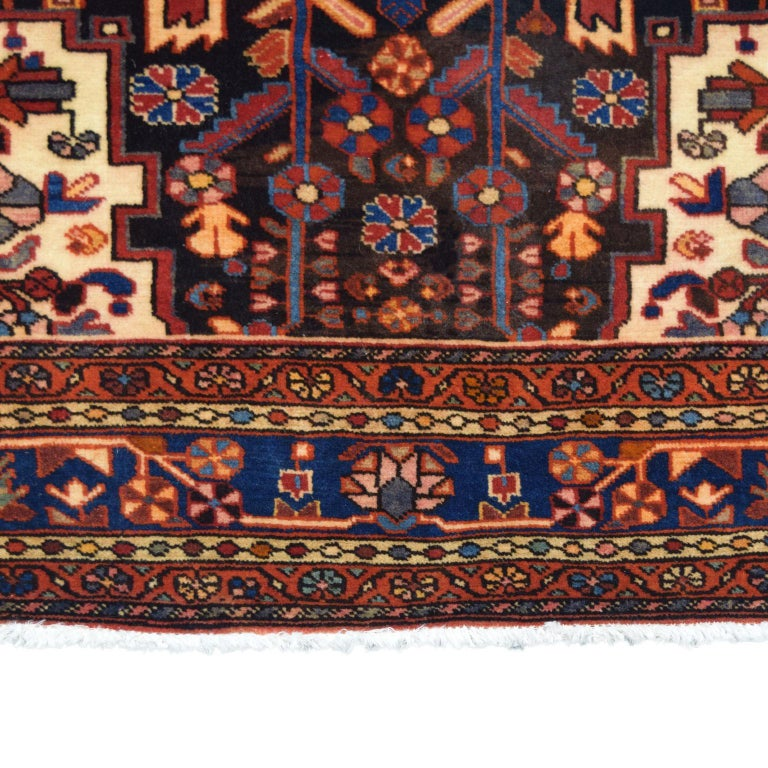 Woven in the Hamadan province of Iran, this traditional Persian carpet is hand-knotted and belongs to Orley Shabahang's World Market Collection. The hand-knotted construction produces a pile that is soft and plush and a functional and durable