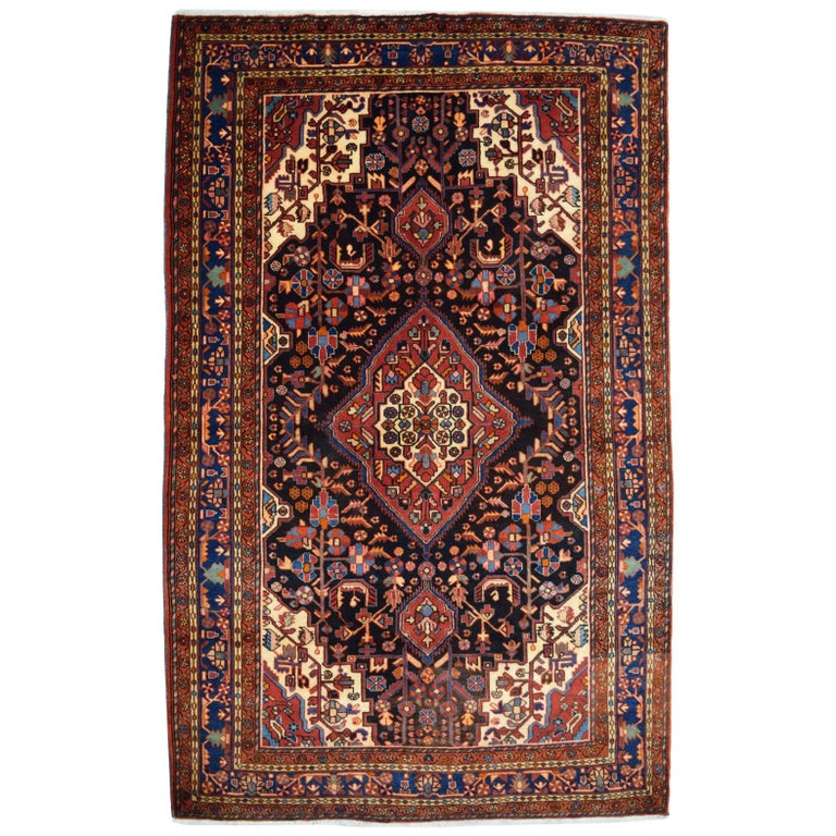 Traditional Persian Nahavand Carpet in Red, Black and Cream Wool For Sale