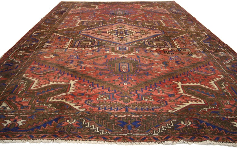 76241, traditional vintage Persian Heriz rug with modern Rustic style. This hand knotted wool vintage Persian Heriz rug features a large serrated octofoil medallion with palmette pendants floating in the center of an abrashed red field. The