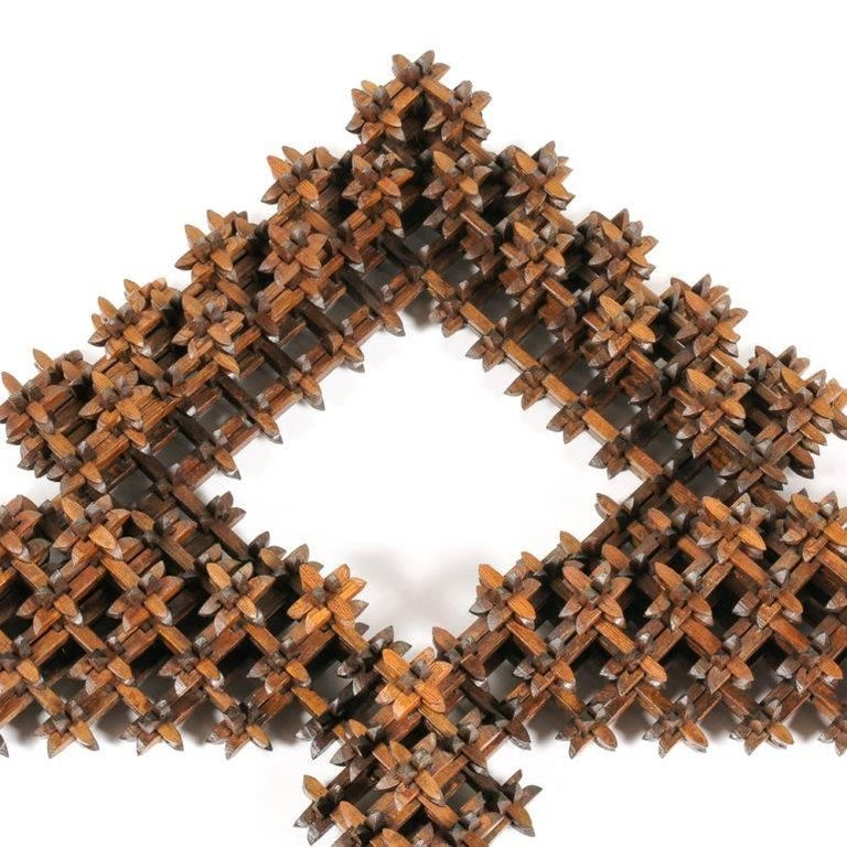 A very unusual American Folk Art or 'Tramp Art' double picture frame comprised of thousands of carved and joined pieces, the whole held together with the joinery alone, without glue or nails, circa 1900.  Tramp Art was an art movement found