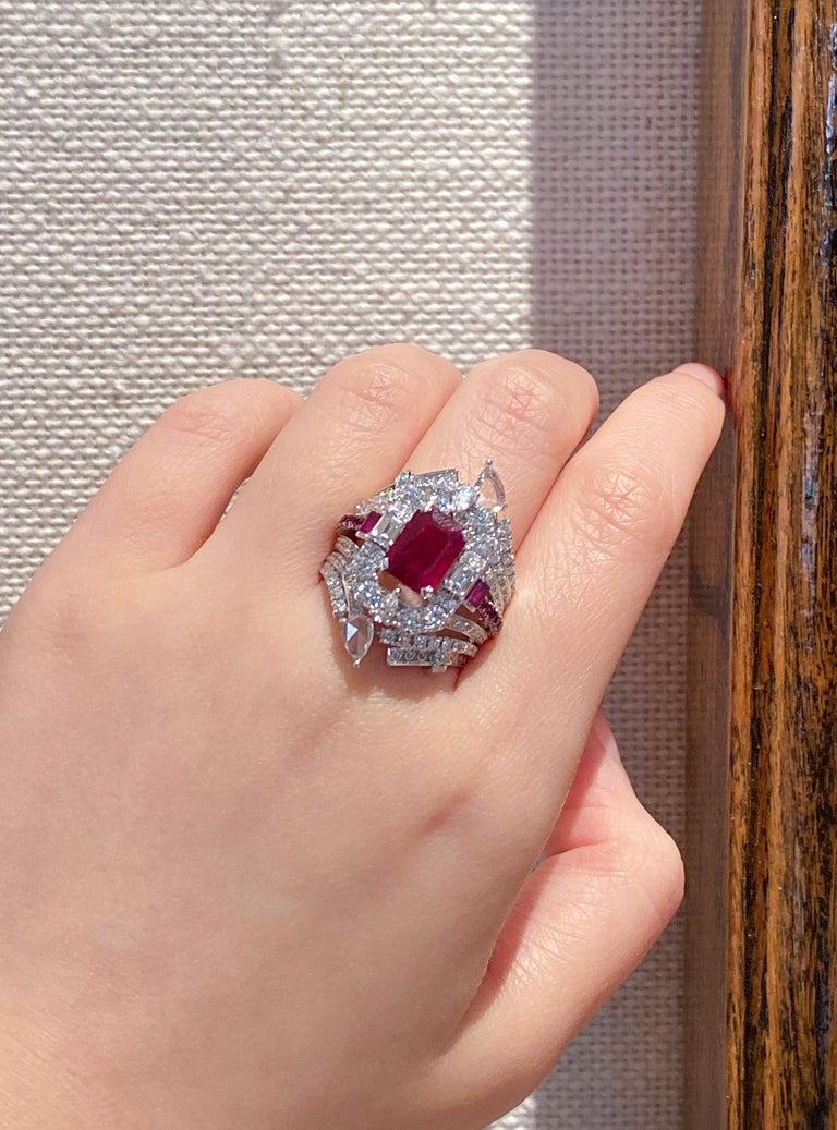 Dilys' 18 karat white gold transformable cocktail ring is set with a 2.07 carat GRS-certified Burmese Pigeon's Blood Ruby centre stone, featuring a deep yet transparent red. Transformable and versatile, this ring can be worn simply as a solitaire