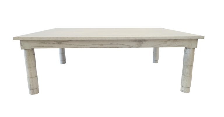 Martin and Brockett's Jenks coffee table is a clean-lined transitional turned leg coffee table. It is shown in our Italian gray finish on oak  Part of our Jenks collection.   Available in additional sizes and finishes.  Lead-time 10-12 weeks.