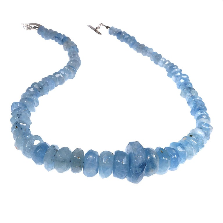 17 Inch necklace of translucent blue Aquamarine rough cut rondelles.  These gorgeous graduated Aquamarines will make your head spin. This handmade necklace is secured with a Sterling Silver toggle.  To see more from this designer enter 'gemjunky' in