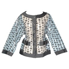 Transparent plastic jacket with grey Moschino embroidery