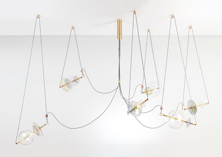 The Trapezi contemporary chandelier is inspired by the idea of a Circus Trapeze Artist.