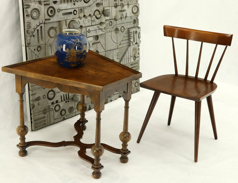 Baker occasional side table sitting on turned legs decorated with big turned walnut balls. X shape stretcher.