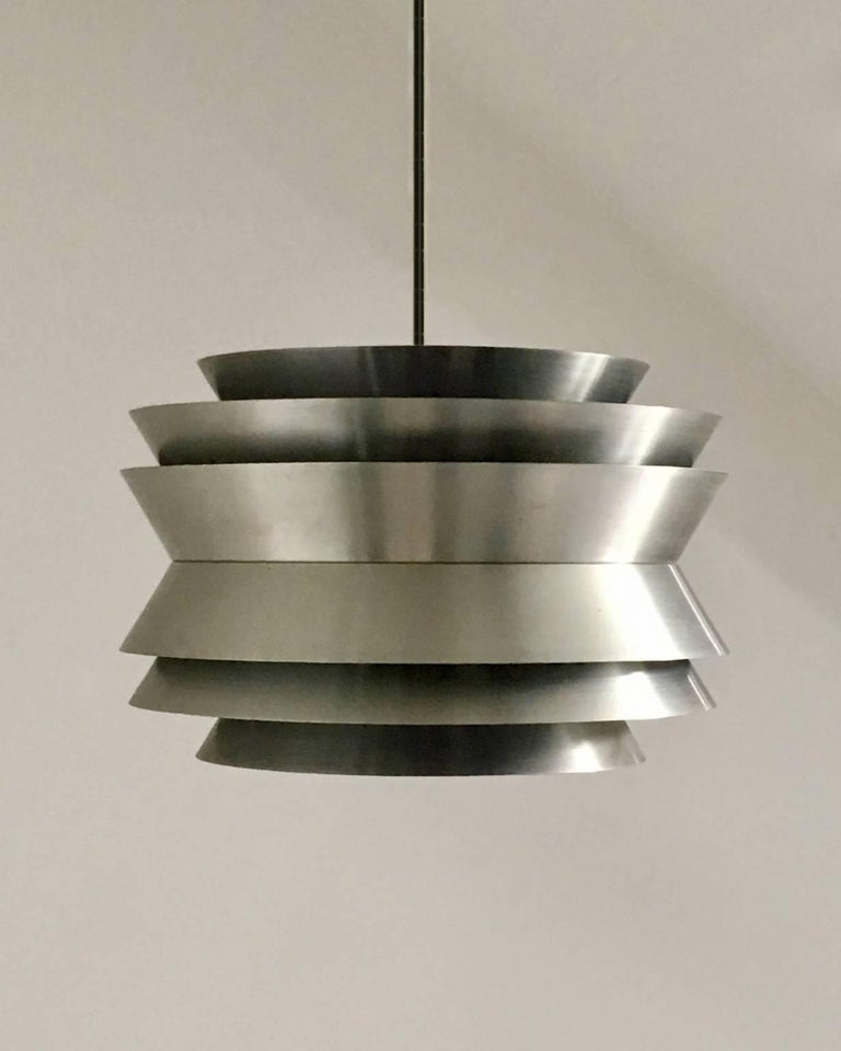 *** Please contact us if you would like details of availability of this item. ***  Trava pendant light by Carl Thore for Granhaga, Sweden, 1960s.  A multi-layered pendant light in spun aluminium with purple inner finish, Sweden, 1960s.   Good
