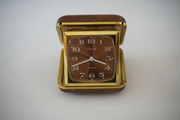 Brass with a red faux leather cover
