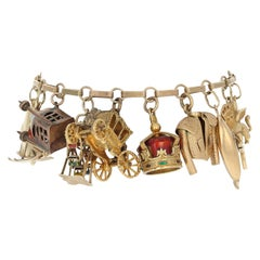 Travel and Leisure Charm Bracelet 14 Karat Gold Coral Pearl Enamel Accents